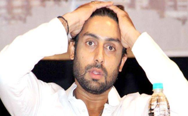 Abhishek Bachchan trolled for laughing at Rajan Nanda's prayer meet
