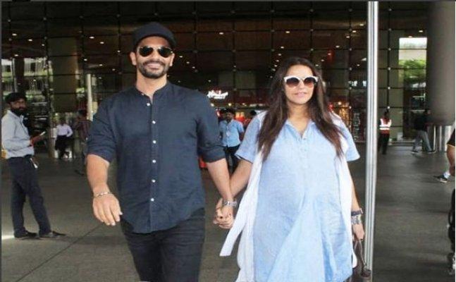 Pregnant Neha Dhupia flaunts her baby bump at airport