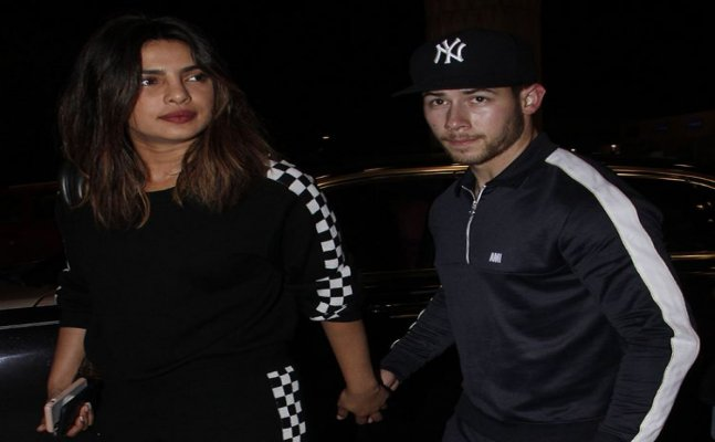 Priyanka Chopra and Nick Jonas leave for US, spotted at airport
