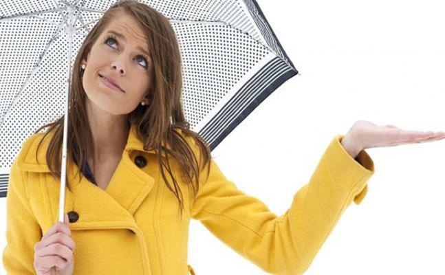 Monsoon essentials in a girl`s handbag