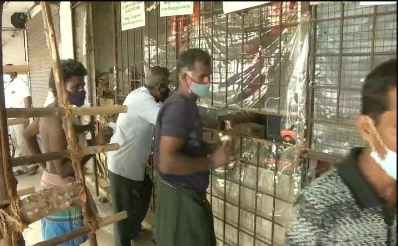 Watch: Madurai Man worships liquor bottles, crowds throng reopened liquor stores in Tamil Nadu