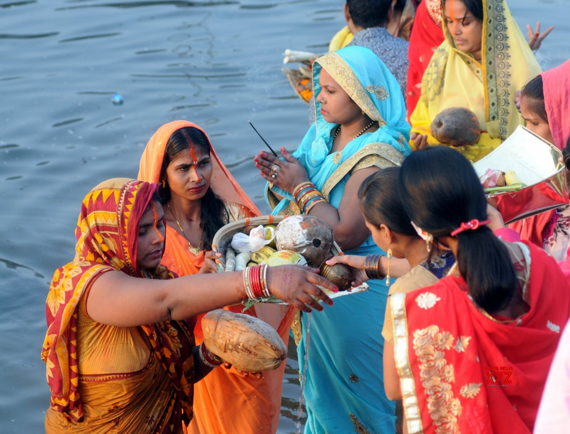 Crowds, many without masks, at ghats of Hindon as devotees offers prayers for Chhath