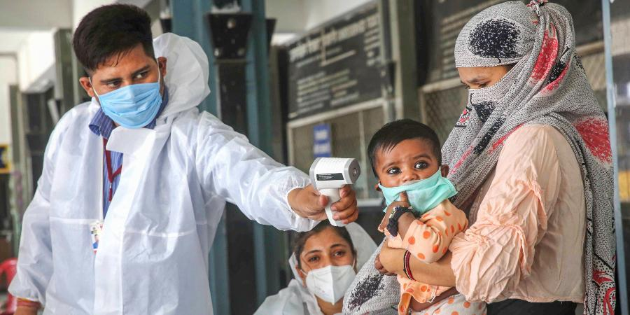 Western regions see surge in number of covid-19 cases; distribution of free mask begins at fair price shops