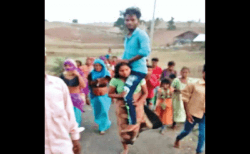 Women humiliated, made to carry her husband on shoulder as punishment for eloping
