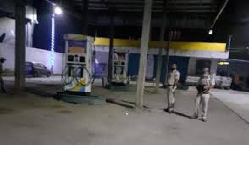 Militants throw a hand grenade at a petrol pump at Mayengbam Leikai in Imphal