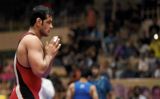 Sushil Kumar bags gold via three walkover, Should he accept the gold medal?